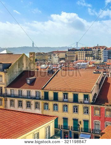 Top View Of Old Medieval Lisbon, Portugal. Rooftop European City Landmark. Vintage Architecture Of E