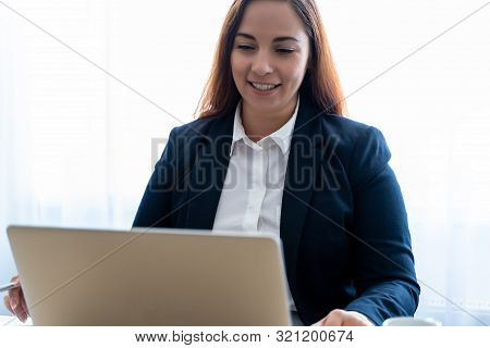 Distant Teacher Smiling And Talks On Video Call Or Link On Laptop With Remote Student Or Friend, Web