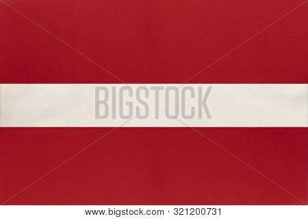 Latvia National Fabric Flag, Textile Background. Symbol Of International European World Country. Lat