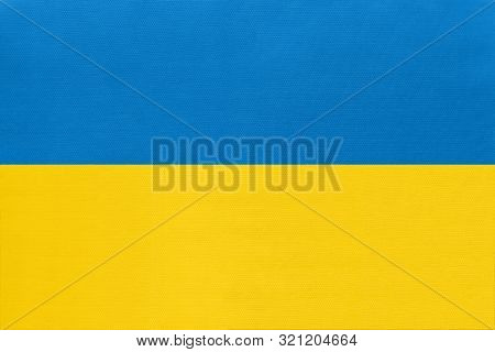 Ukraine National Fabric Flag, Textile Background. Symbol Of International World European Country. St