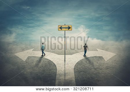 Two Men Change The Common Route Going Different Roads. Split Crossroad Fork Junction, People Choose