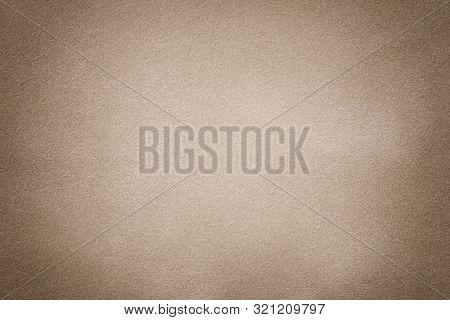 Light Brown Matte Background Of Suede Fabric, Closeup. Velvet Beige Texture With Vignette.
