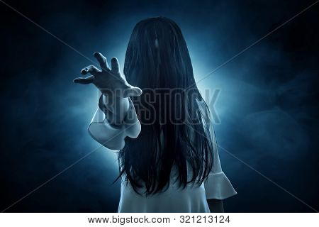 Scary Ghost Woman Horror Scene On Dark Background