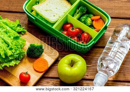Lunch Box For Kid With Fresh Vegetables On Wooden Background
