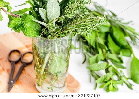 Summer Bouquet Of Spicy Herbs In Glass Close Up