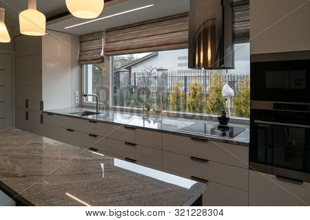 Modern Kitchen Furniture With Marble Worktops , Drawers, Cabinets, Faucet By A Kitchen Sink, Hob, St
