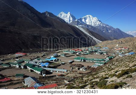 Sagarmatha national park, Dingboche, Nepal - May 20, 2019: View of Dingboche village (4410 m) from the trail of Everest trek