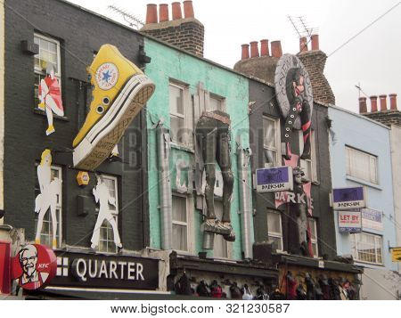 Nice Facades Of Shops Phenomenally Decorated With Pnatalones And Giant Slippers In The Camden Distri
