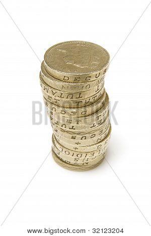 Pound coins on a white background.