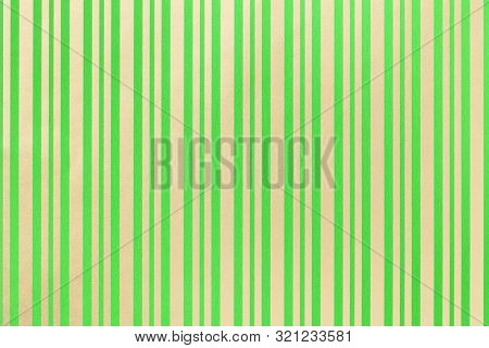 Dark Green And Golden Background From Wrapping Paper With A Pattern Of Line Closeup. Texture Of Holi