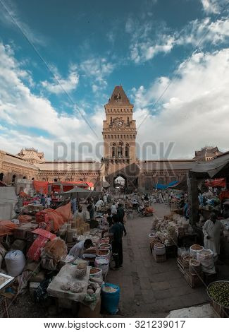 People Selling Different Things In The Beautiful Architecture Of Empress Market Karachi Building, A