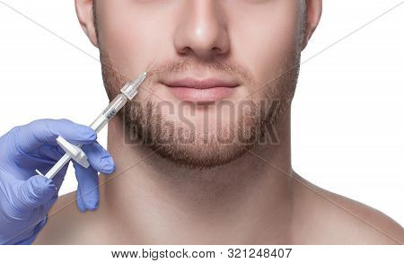 Men's Cosmetology. Beautician Makes A Man A Rejuvenation Injection Procedure On His Face.