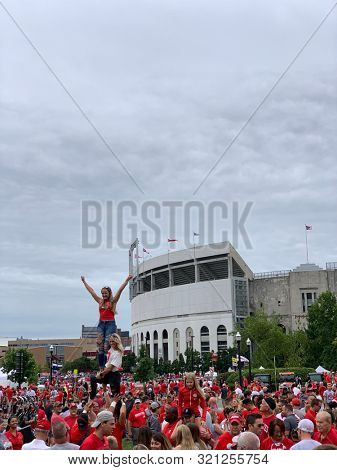 COLUMBUS, OHIO - AUGUST 31,2029:  Pre-game festivities outside the football Ohio Stadium, home of the Ohio State Buckeyes are exciting.  Crowds gather to watch the band and the cheerleaders.