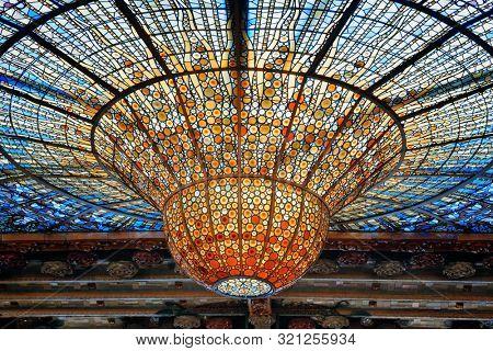 BARCELONA, SPAIN – MAY 13, 2019: Ceiling lamp of the Palau de la Musica Catalana ((Palace of Catalan Music) Hall.