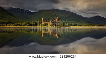 Kilchurn Castle Reflection In Loch Awe At Sunset, Highlands, Scotland