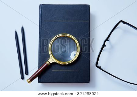 Magnifying Glass On The Book. Mockup, Copy Space. Analysis And Analytic Concept. Education, Question
