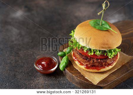 Top View Of Vegan Burger On Dark Rustic Brown Background