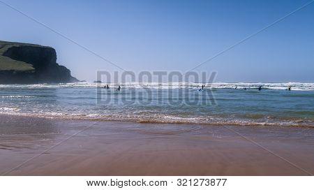 Beachgoers On Mawgan Porth Beach, North Cornwall, England, Uk