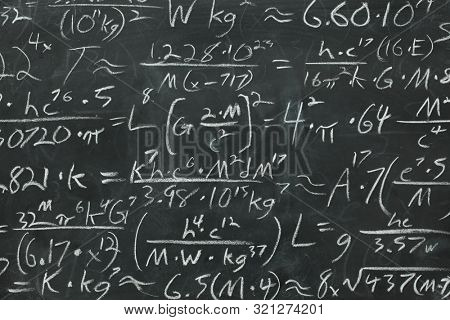 Math equations and formula written in chalk on messy chalkboard or blackboard background. School or scientific research concept.