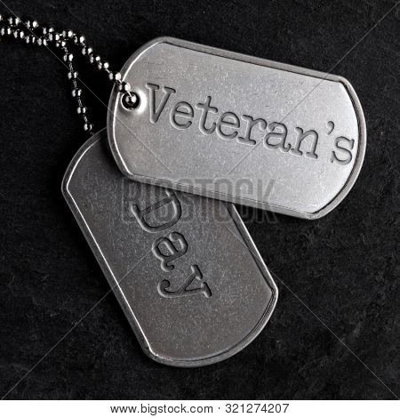 Old and worn military dog tags - Veteran's Day