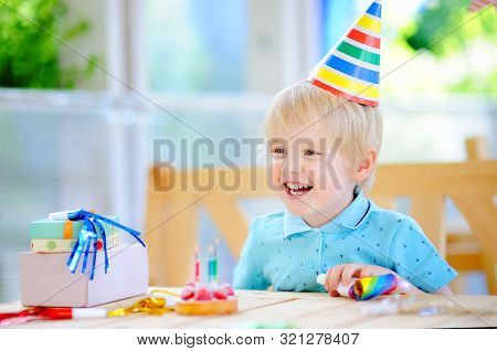 Cute Little Boy Having Fun And Celebrate Birthday Party With Colorful Decoration And Cake. Child Wit