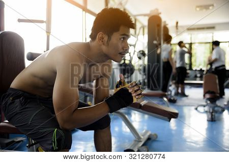 At Gym,sport Asian Man Feeling Tired, Depressed,about Unsuccessful Excercise,workout In Gymnasium.ad