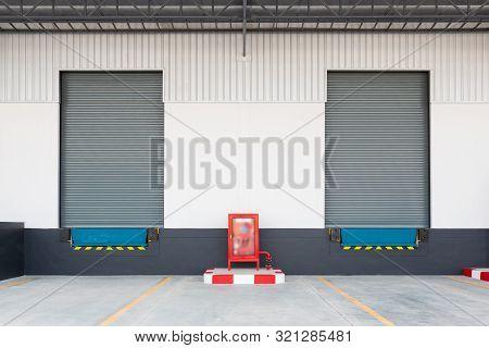 Shutter Door Or Roller Door And Concrete Floor Outside Factory For Loading And Unloading Goods In In