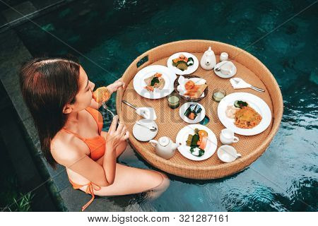 Floating Breakfast In Infinity Pool On Paradise Swimming Pool, Morning In The Tropical Resort Bali,