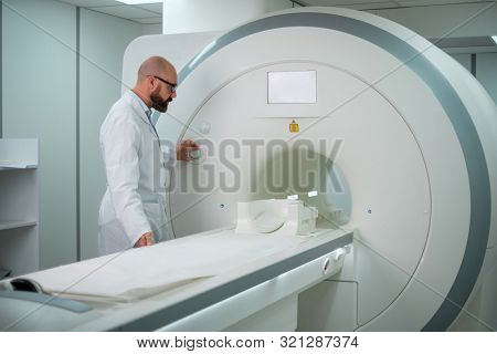 Doctor preparing MRI scanner in a hospital