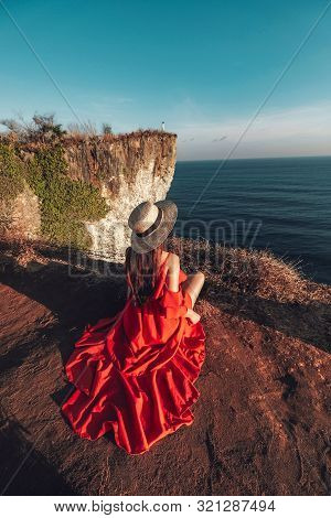 Couple Adventure And Looking View On The Karang Boma Cliff At Uluwatu Bali In Indonesia