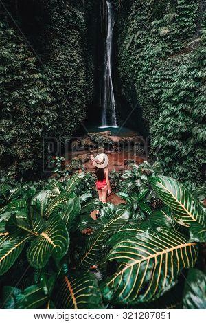 Traveling Young Woman With Tropical Rainforest In Bali Enjoying Life At Beautiful Lake Lake Waterfal