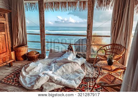 Woman Enjoying Morning Vacations On Tropical Beach Bungalow Looking Ocean View Relaxing Holiday At U