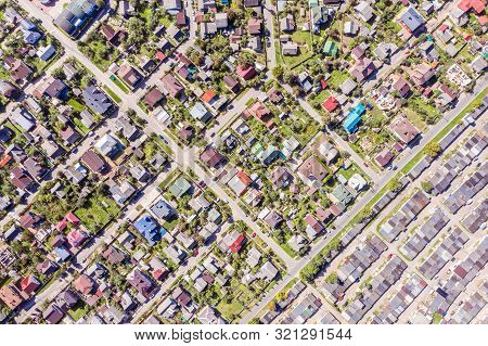 Aerial View Of A Suburban Residential Neighborhood On A Sunny Summer Day
