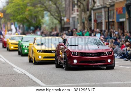 Holland, Michigan, Usa - May 11, 2019: Tulip Time Parade, A Group Of Camaros Going Down The Road Dur
