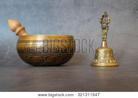 Singing Bowl And Golden Bell Close-up, Soothing And Meditative. Singing Bowl With Sanskrit Engraving