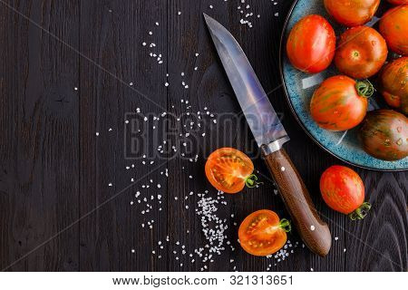 Red, Ripe Tomatoes On A Dark Background. Harvesting Tomatoes. Top View. Copy Space