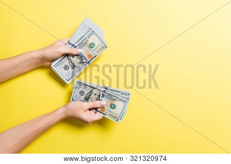 Top View Of Female Hand Giving Some Money, Close-up Of Counting One Hundred Dollar Bills. Business C