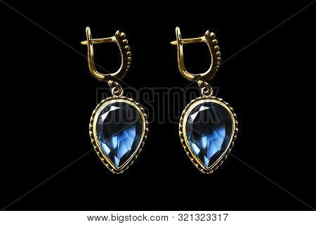 Vintage Gold Earrings With Large Sapphires Isolated Over Black
