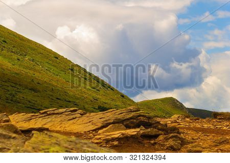 Summer Landscape In The Carpathian Mountains. View Of The Mountain Peak Hoverla