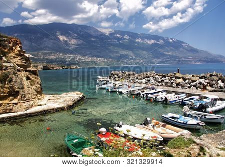 Small Harbor For Fishing Boats On The Island Of Kefalonia. Greece