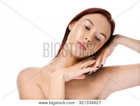 beauty portrait of attractive young caucasian young woman brunette isolated on white studio shot face skin looking at camera hands
