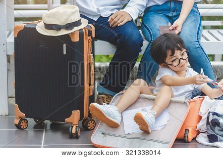 Father Mother And The Son Hold Passport, Map To Trip Family Preparing For Traveling We Are Poses Sel