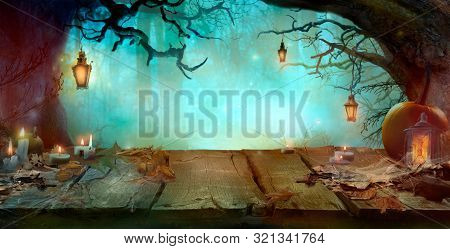 Halloween Background With Table And Lanterns In Dark Forest In Spooky Night. Halloween Design In Mag