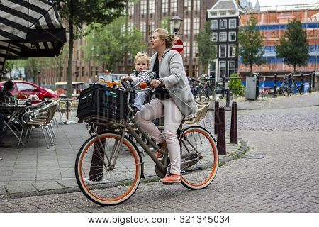 Amsterdam, Holland - July 1, 2017: Amsterdam Is One Of The Most Well Known Bicycle Friendly Cities W