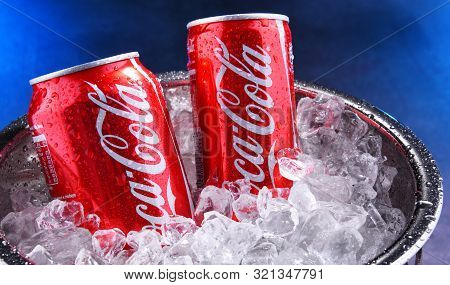Cans Of Coca-cola In Bucket With Crushed Ice