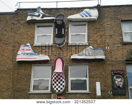 Nice Facades Of Shops Phenomenally Decorated With Several Giant Slippers In The Camden District In L