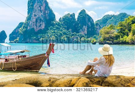 Beautiful Woman On Paradise Ao Nang Krabi Thailand Beach With Llongtail Boat. Adventure, Travel, Rel