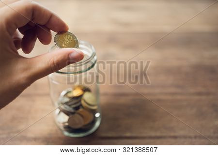 Business Men Put The Coin In A Glass Jar To Save Money, Save Money On Investments, Spend Money When