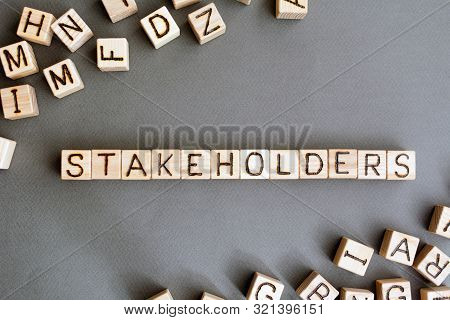 The Word Stakeholder Wooden Cubes With Burnt Letters, Business Development In Favor Of Shareholders