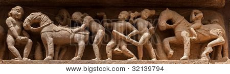 Famous erotic stone carving bas relief panorama, Lakshmana Temple, Khajuraho, India. Unesco World Heritage Site
